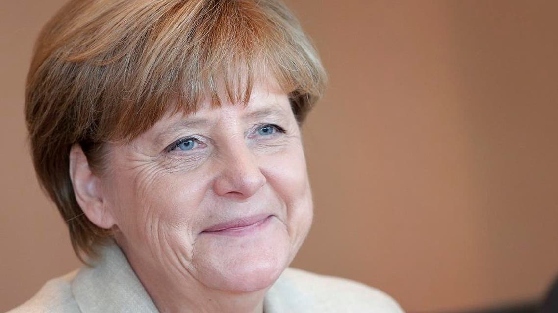 German Chancellor Angela Merkel smiles as she arrives for the weekly cabinet meeting in Berlin, Germany, Tuesday, Sept. 29, 2015. (AP Photo/Michael Sohn)
