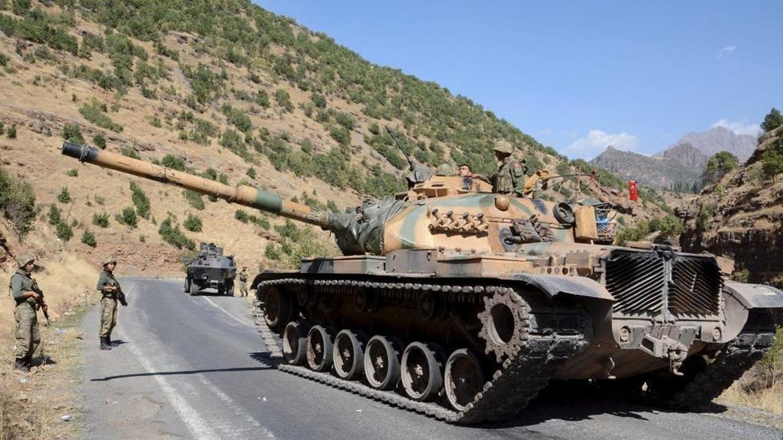 Turkish soldiers in a tank and an armored vehicle patrol on the road to the town of Beytussebab in the southeastern Sirnak province, Turkey. (File: Reuters)