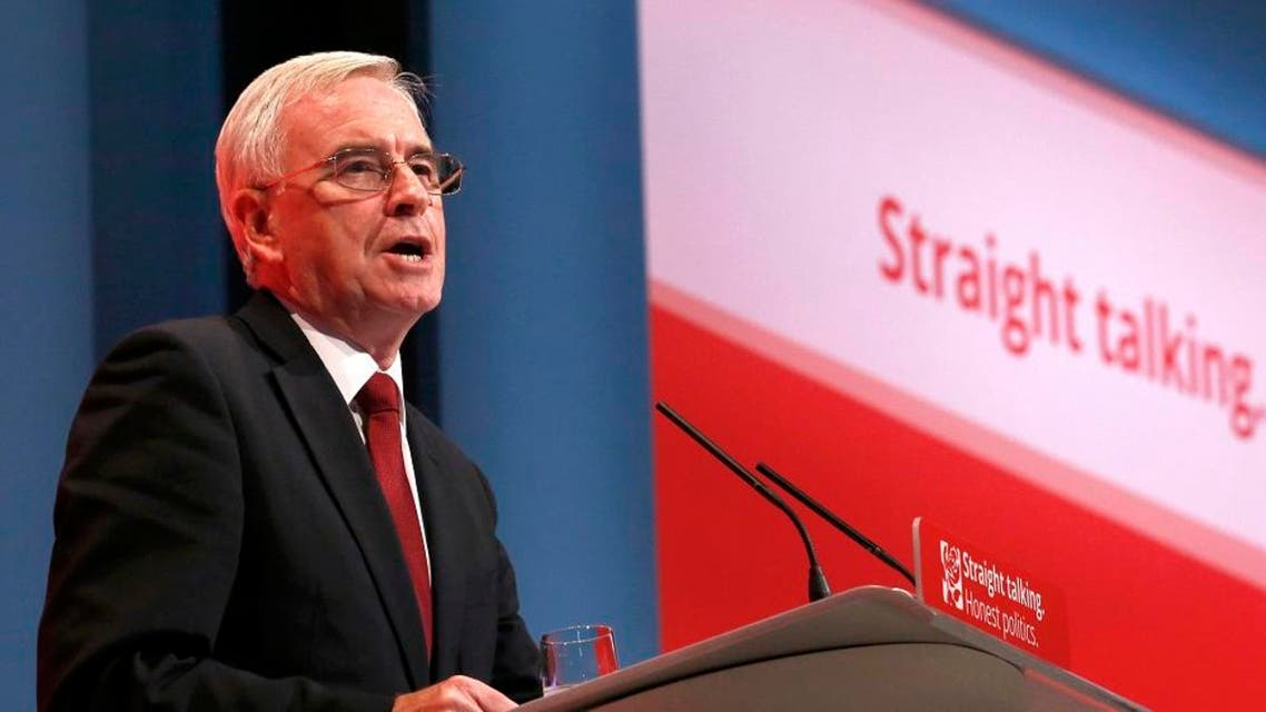 Britain's shadow Chancellor of the exchequer John McDonnell speaks on stage at the annual Labour Party Conference in Brighton, southern Britain 28 September, 2015. REUTERS/Luke MacGregor