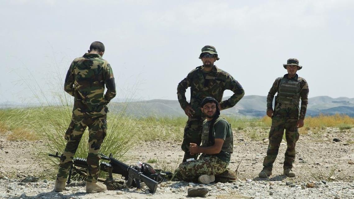 In this Wednesday, Aug. 5, 2015 file photo, Afghanistan's National Army soldiers take positions in Khogyani district, in Nangarhar province, east of Kabul, Afghanistan. AP