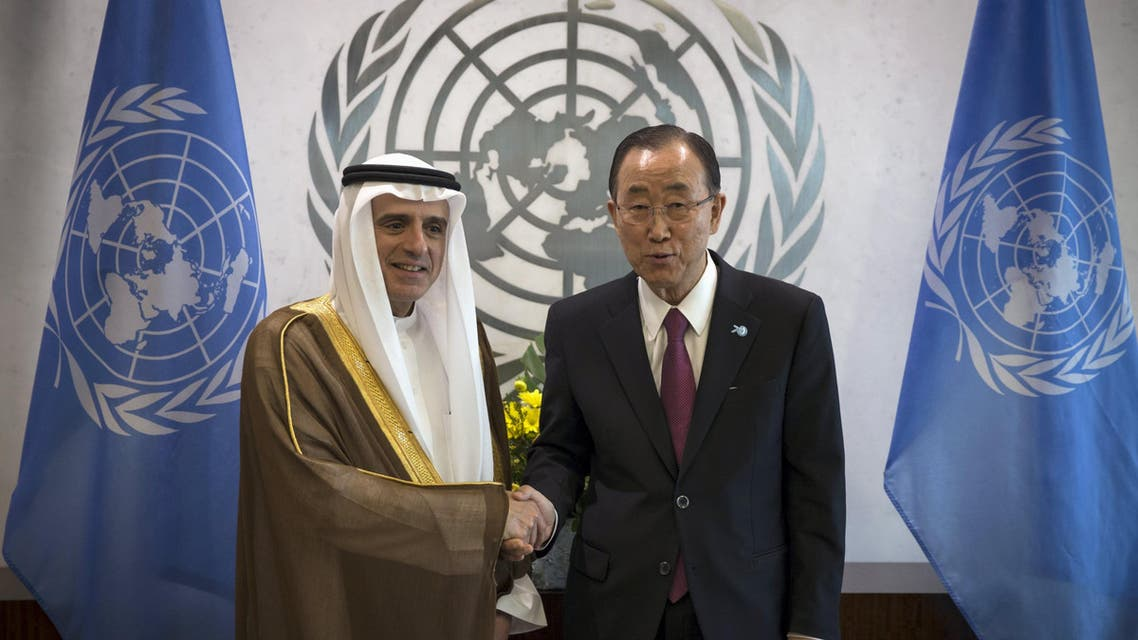 Al-Jubeir and Ban Ki-moon pose for photographers in the United Nations Secretary General's office at the United Nations headquarters in Manhattan. (Reuters)