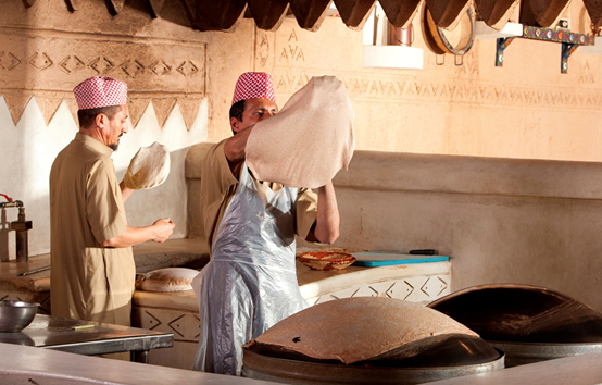Baking Arabic flatbread Photo credit: Najd Village Restaurant