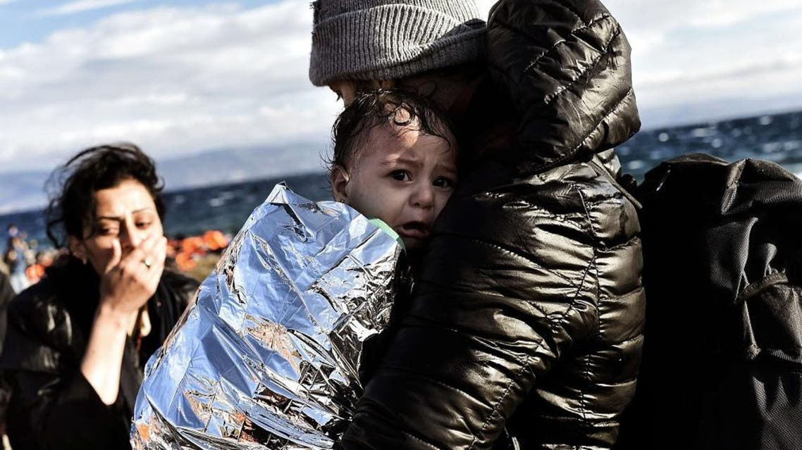 Refugees and migrants arrive at the Greek island of Lesbos after crossing the Aegean sea from Turkey on September 30, 2015. AFP