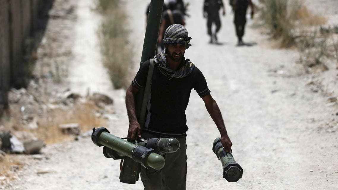 File photo of Free Syrian Army' fighter carrying a weapon as he walks towards his position on the frontline against the forces of Syria's President Assad in Jobar, a suburb of Damascus. (Reuters)