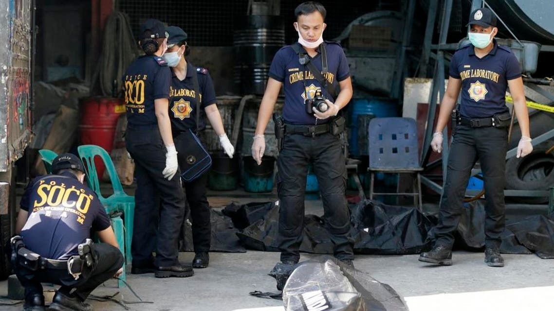 Scene of the Crime Operatives of the Philippine National Police in Valenzuela city, a northern suburb of Manila, Philippines, Thursday, May 14, 2015. (AP)