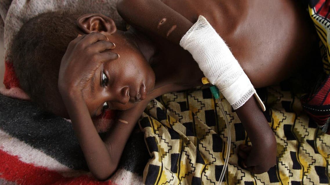 A child suffering from malnutrition lies in a make shift hospital in the town of Aguie, 70 kms (43 miles) from Maradi, Niger on Tuesday July 26, 2005.