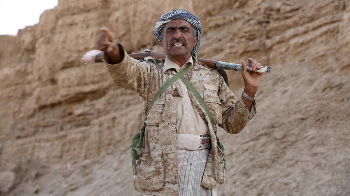 A tribal fighter loyal to Yemen's government gestures as he stands at the frontline of fighting against Houthi militants in the central province of Marib. (File: Reuters)
