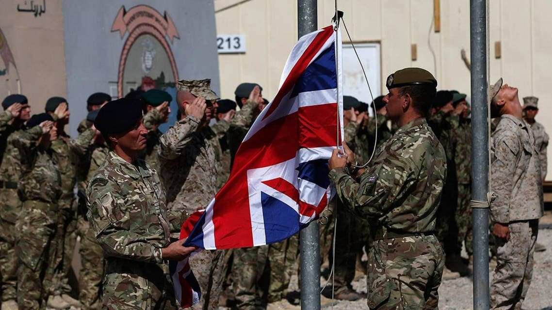 British troops lower the Union flag during a ceremony marking the end of operations for US and British combat troops in Helmand province, Afghanistan. (Reuters)