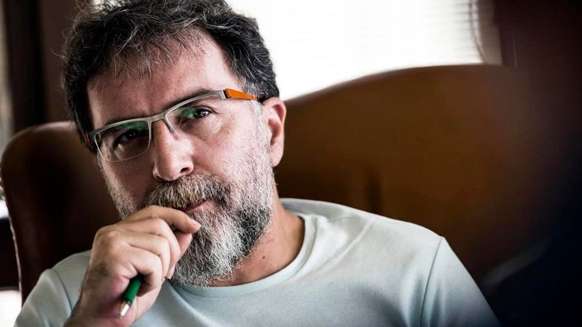 In this 2015 file photo, Ahmet Hakan Coskun, a Hurriyet newspaper journalist, as he listens during an interview in Istanbul, Turkey. ap