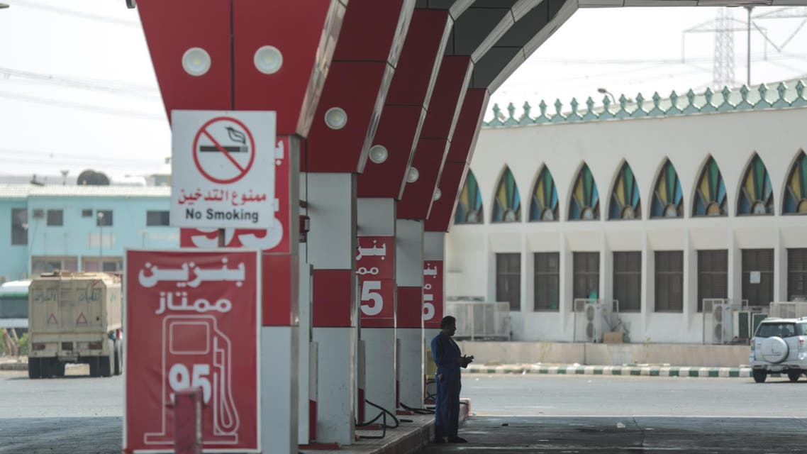 In this Thursday, Sept. 17, 2015, photo, a worker waits for cars at a gas station in Mecca, Saudi Arabia. A drop in oil revenue is forcing Saudi Arabia to weigh its first cuts to welfare and investment in years. (AP Photo/Mosa'ab Elshamy)