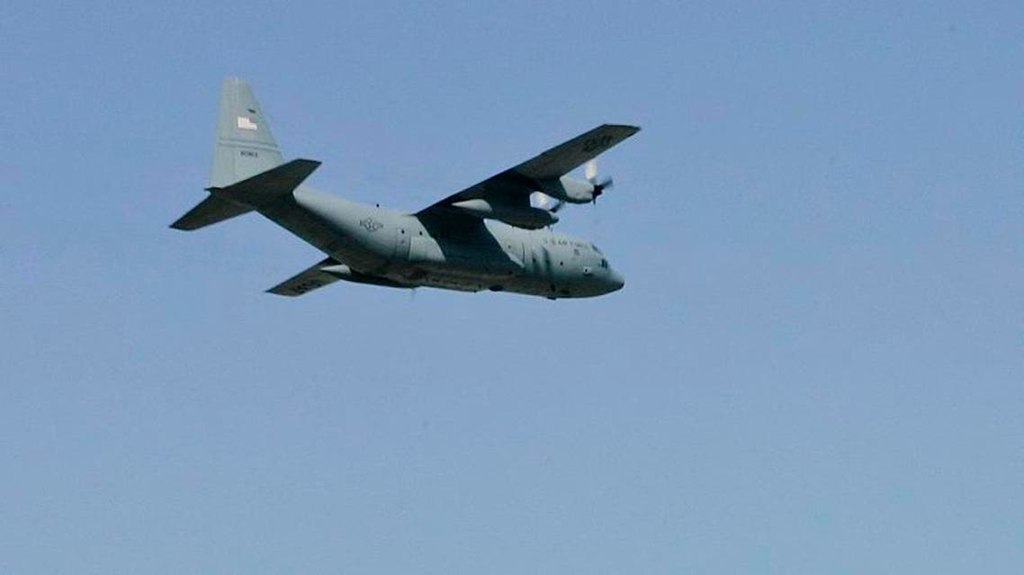 One of the last three C-130 Hercules military cargo planes fly over the hanger and out of Will Rogers Air National Guard Base in Oklahoma City, Thursday, Sept. 20, 2007. (File photo: AP)