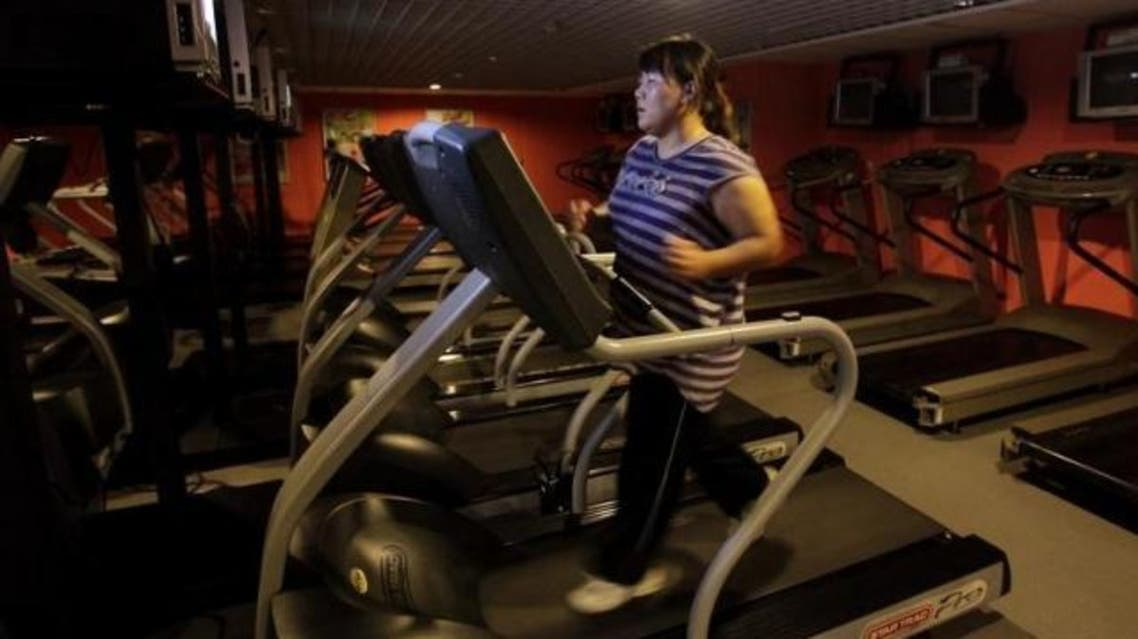 A woman runs on a treadmill as part of her training during a six-week programme in an exercise room at the Bodyworks weight loss campus in Beijing August 26, 2011. (Reuters)