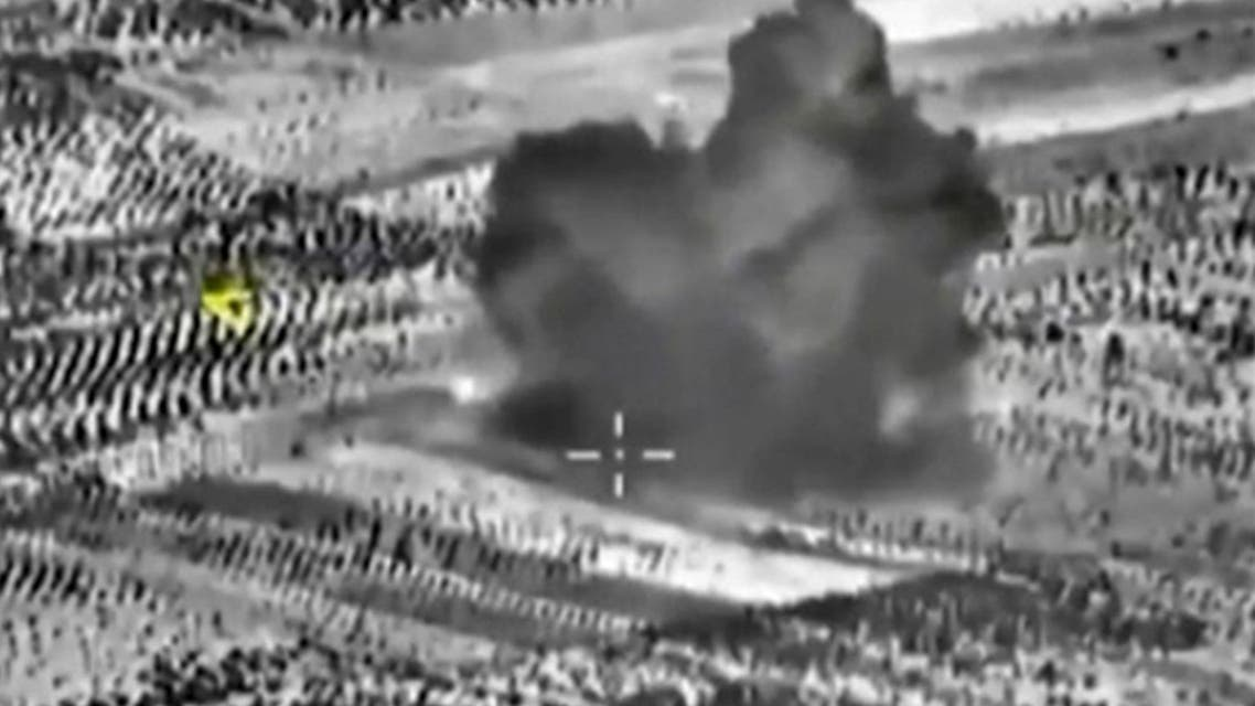 A frame grab taken from footage released by Russia's Defence Ministry October 3, 2015, shows smoke rising after airstrikes carried out by Russian air force on what Russia says was a bomb factory in Maarat al-Numan, south of the town of Idlib, Syria.  (Reuters