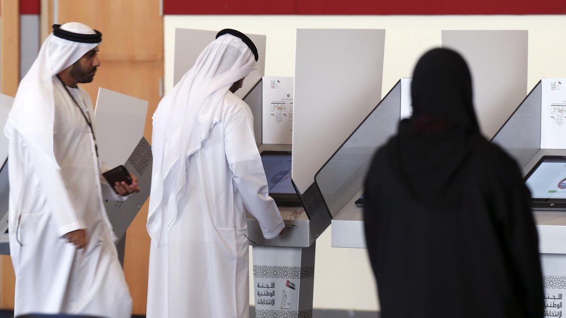 Emiratis cast their vote at a polling centre in the Gulf emirate of Umm al Qaiwain on October 3, 2015 (AFP)