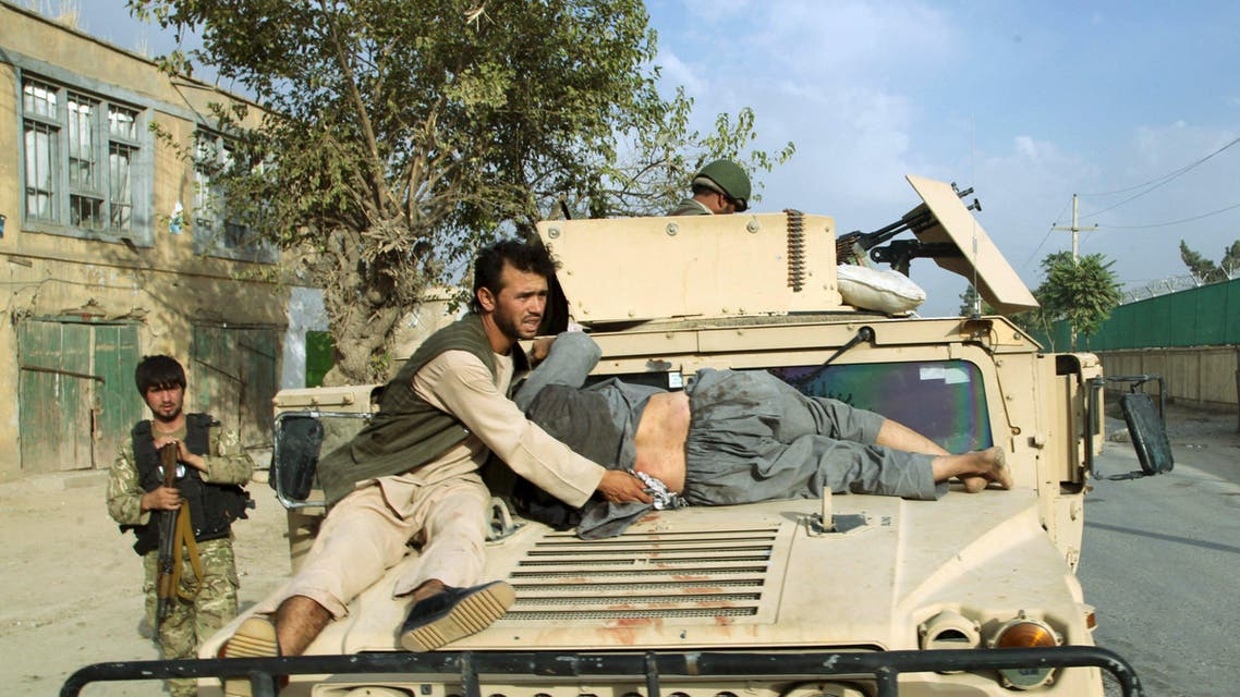 A military vehicle transports an injured civilian after a battle with the Taliban in the city of Kunduz, Afghanistan October 3, 2015. (Reuters)