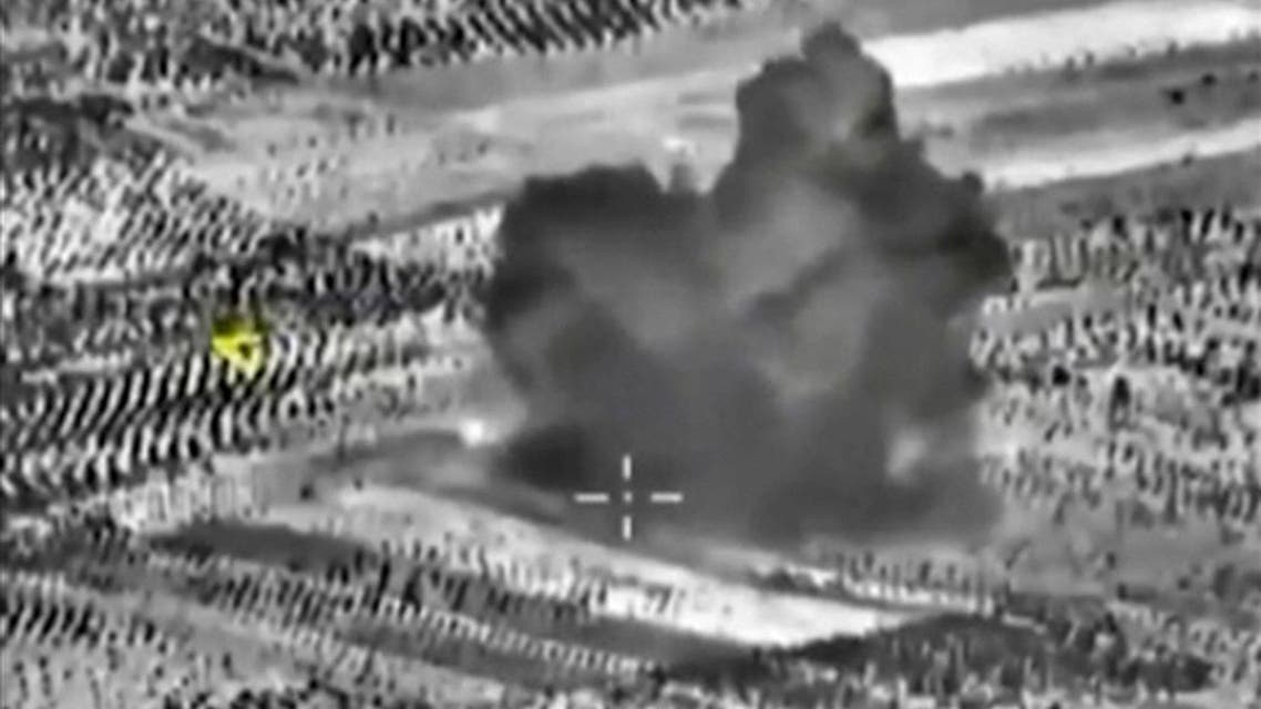 Frame grab taken from footage shows smoke rising after airstrikes carried out by Russian air force in Maarat al-Numan. (Reuters)