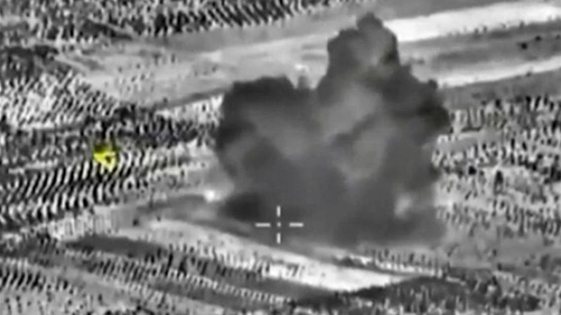 Footage released by Russia's Defence Ministry shows smoke rising after airstrikes carried out by Russian air force on what Russia says was a bomb factory in Maarat al-Numan, south of the town of Idlib. (File: Reutes)