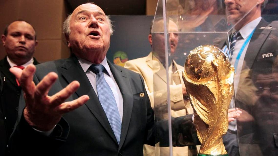 FIFA President Sepp Blatter gestures next to the World Cup trophy. (File: Reuters)