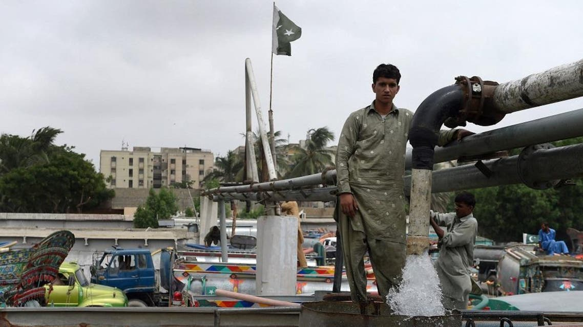 In this photograph taken on August 22, 2015, Pakistani employees fill water tankers at a government hydrant to provide residential areas in Karachi.