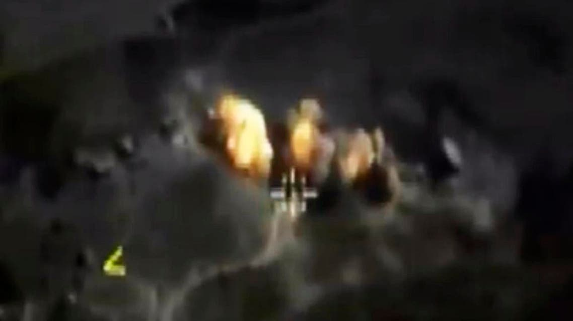 In this photo made from the footage taken from Russian Defense Ministry official web site on Saturday, Oct. 3, 2015 a bomb explosion is seen in Syria. AP