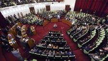 Libya's elected parliament extends mandate, complicating peace talks