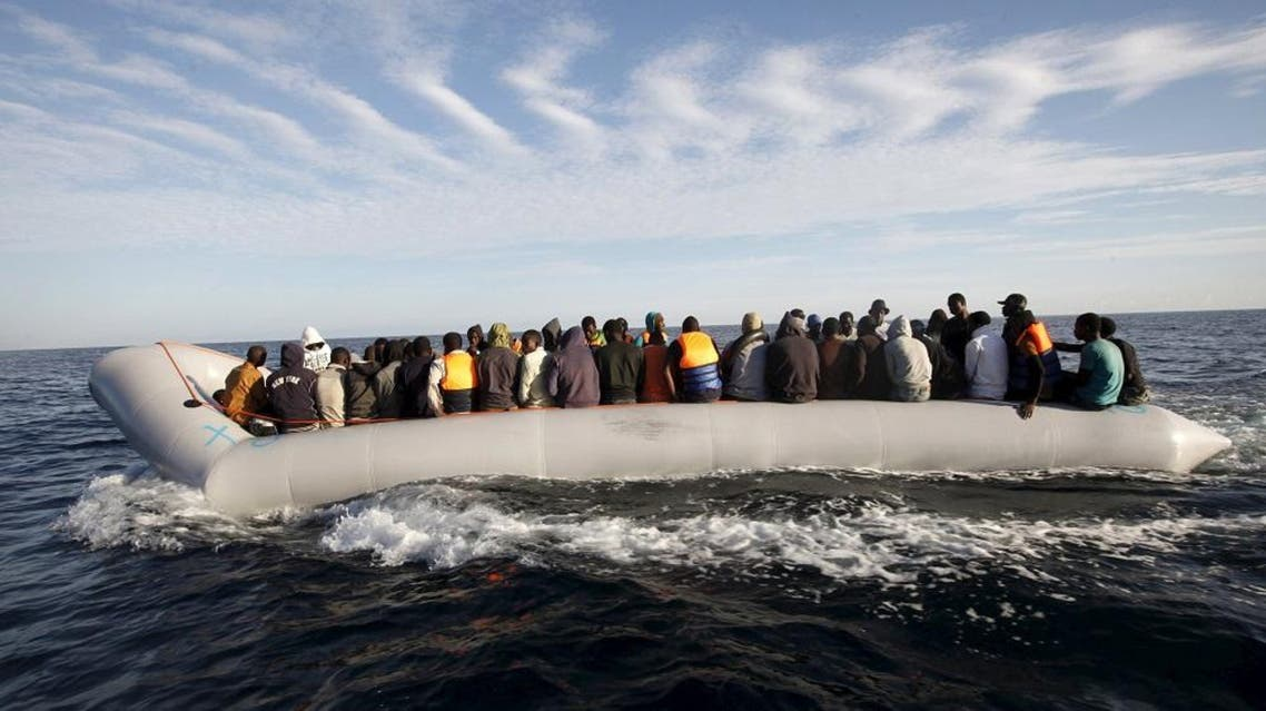 Migrants, who tried to flee to Europe, travel in a dinghy after they were stopped by Libyan coast guards and made to head to Tripoli September 29, 2015. REUTERS