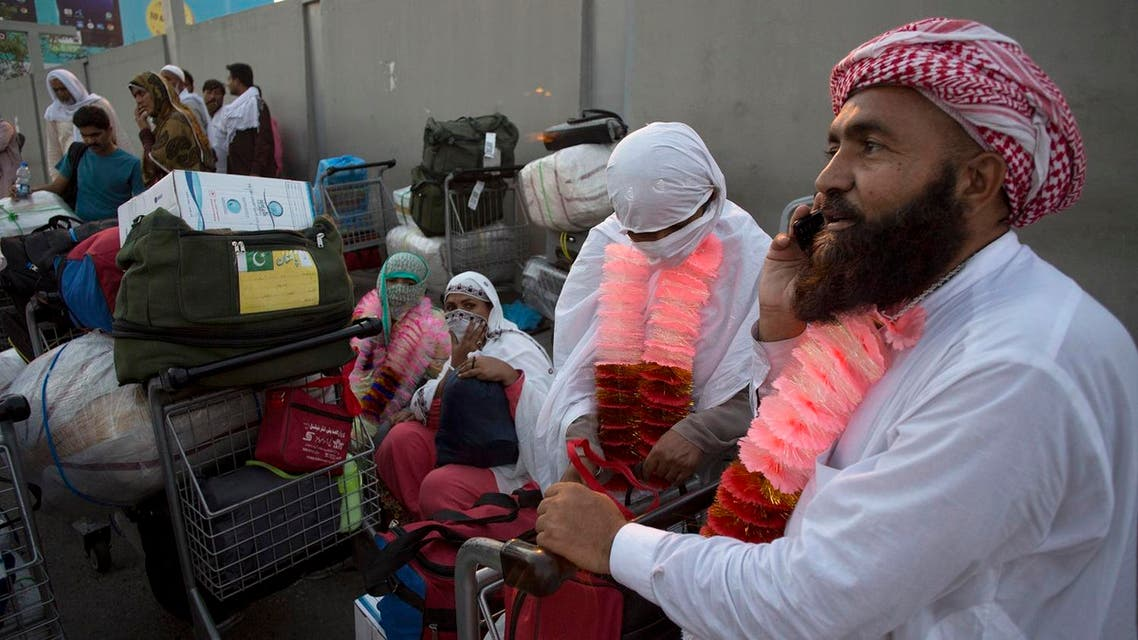 A Pakistani man talks to his family member after arriving at Islamabad airport after performing Hajj. (AP)