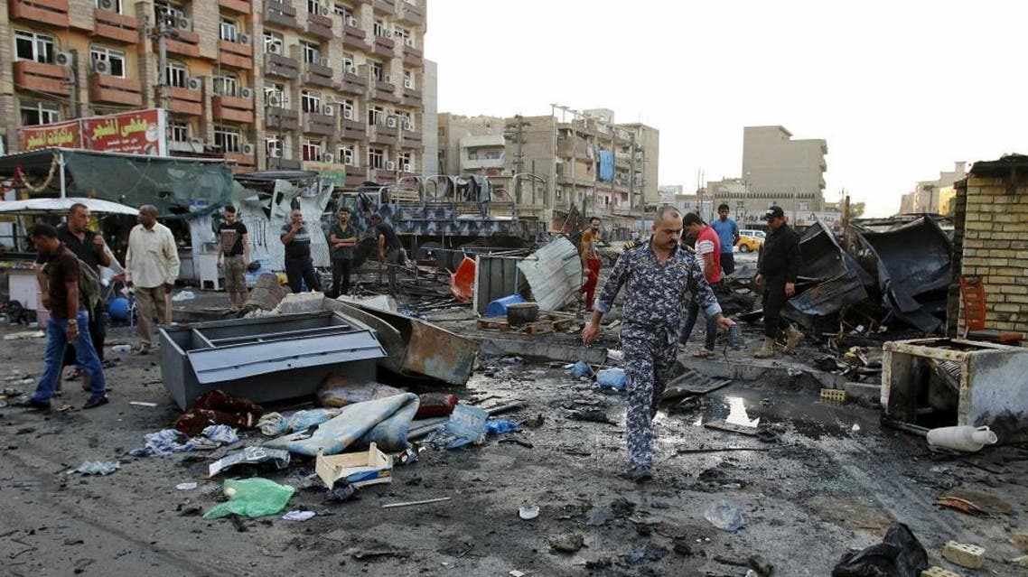 Residents look at wreckage at the site of a car bomb attack in Baghdad, Iraq. (File: Reuters)