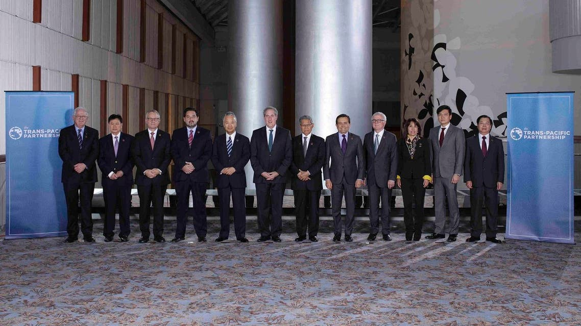 """Trans-Pacific Partnership Ministers meeting post in TPP Ministers """"Family Photo"""" in Atlanta Georgia. (Reuters)"""