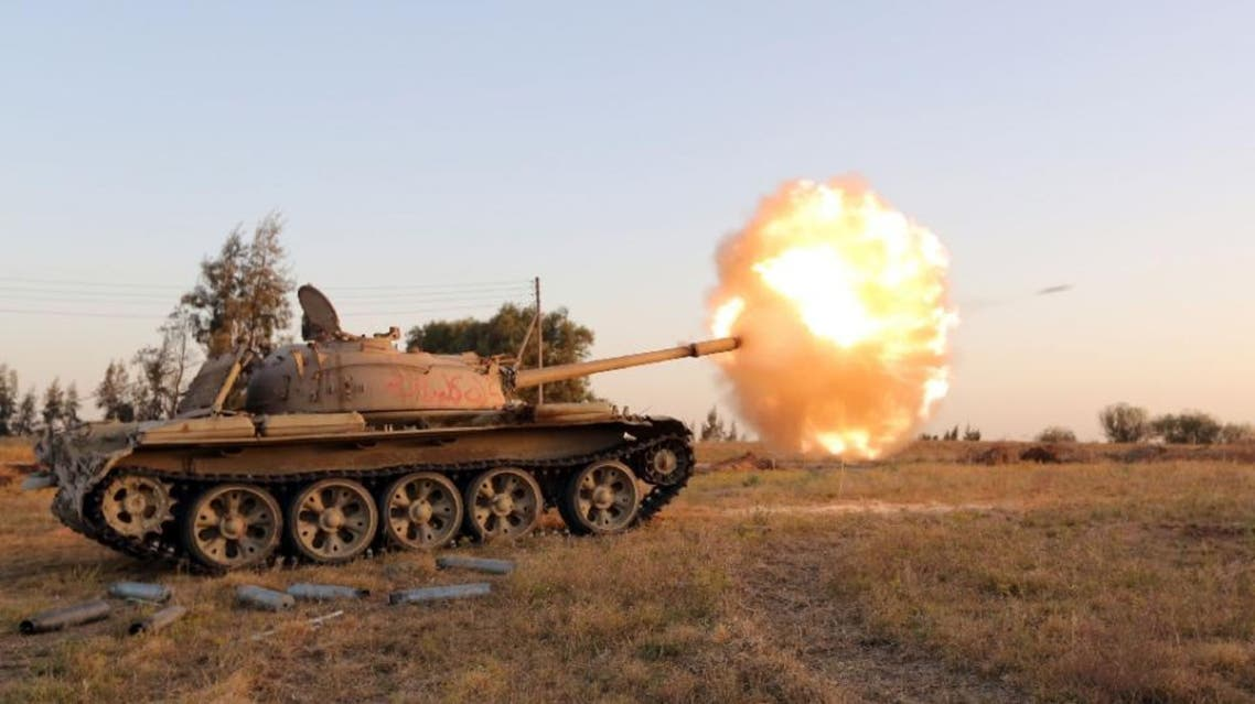 Fighters from the Fajr Libya militia fire shells from a tank during clashes with forces loyal to Libya's internationally recognised government, southwest of Sabratha on April 28, 2015 (AFP)