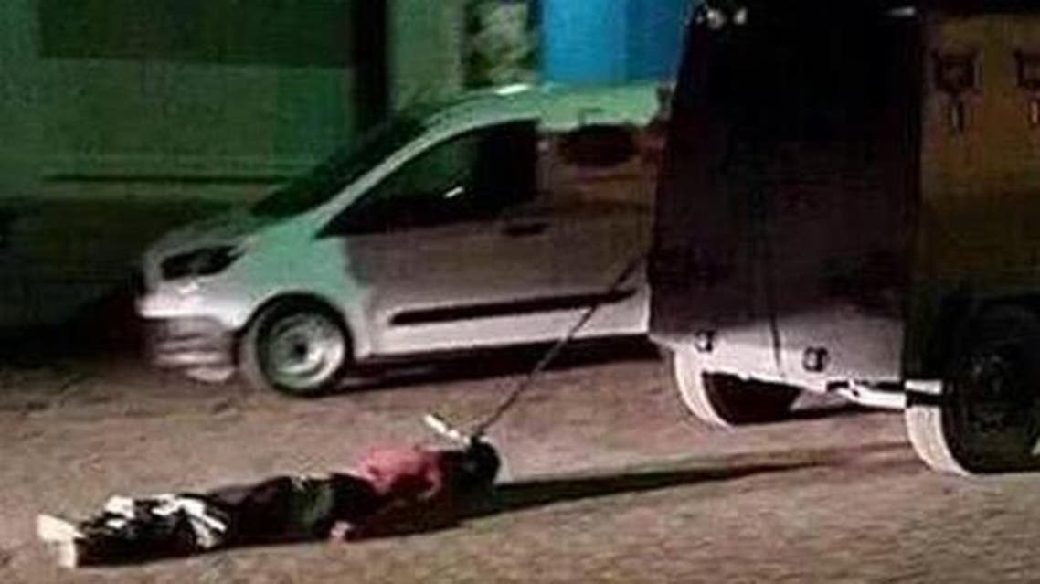 """This photo taken from a Twitter account named """"JİTEM"""" shows a dead body being dragged behind a police vehicle in Şırnak province."""