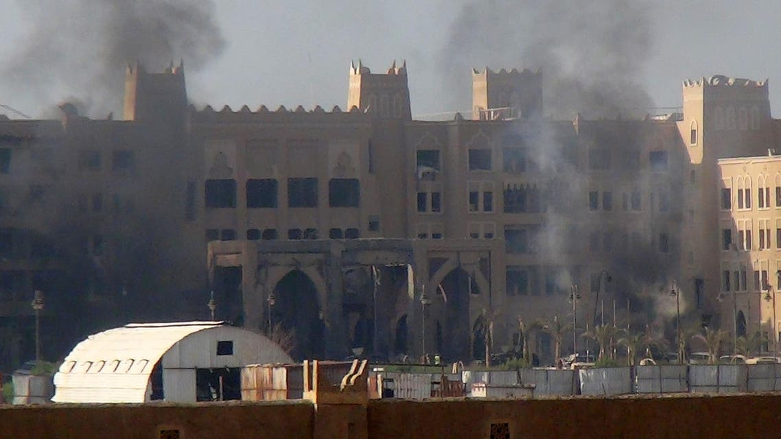 A picture taken on October 6, 2015 shows smoke billowing from the Al-Qasr hotel in Aden's western suburbs after it was hit by a rocket attack. (AFP)