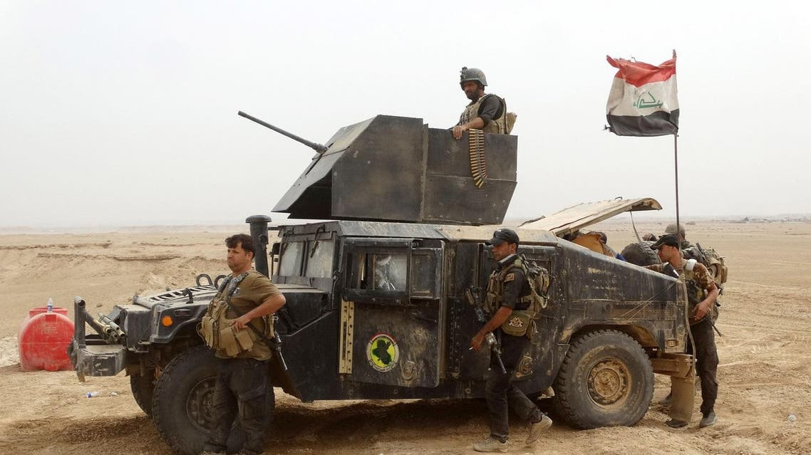 Reinforcements for Iraqi anti-terrorism forces arrive at the Ramadi Stadium after regaining control of the complex and the neighboring al-Bugleeb area. (AP)