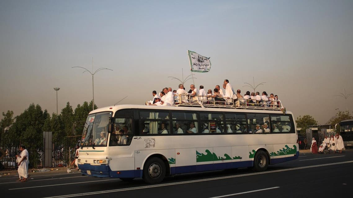 Muslim pilgrims arrive by bus to Arafat to pray on a rocky hill called the Mountain of Mercy, on the Plain of Arafat, near the holy city of Makkah. (AP)