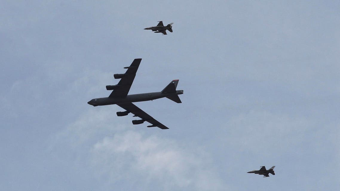 "A U.S. strategic bomber B-52 and two Jordanian F-16 aircraft participate in 18-nation military exercises in a field near the border with Saudi Arabia, in Mudawara, 280 kilometers (174 miles) south of Amman, Jordan, Monday, May 18, 2015. Some 10,000 troops took part in the two-week ""Eager Lion"" exercises hosted by Jordan for the fifth year. (AP Photo/Raad Adayleh)"