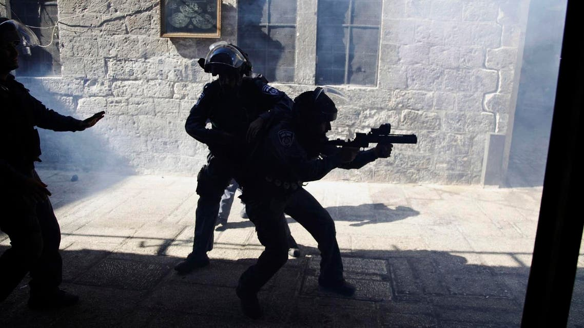 Israeli border policemen fire tear gas during a confrontation in the Old City of Jerusalem. (File photo: AP)