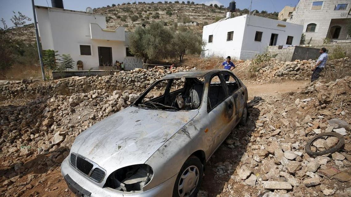 A car belonging to Palestinian residents, which some said was burnt by alleged Jewish settlers, in the occupied West Bank. (Reuters)