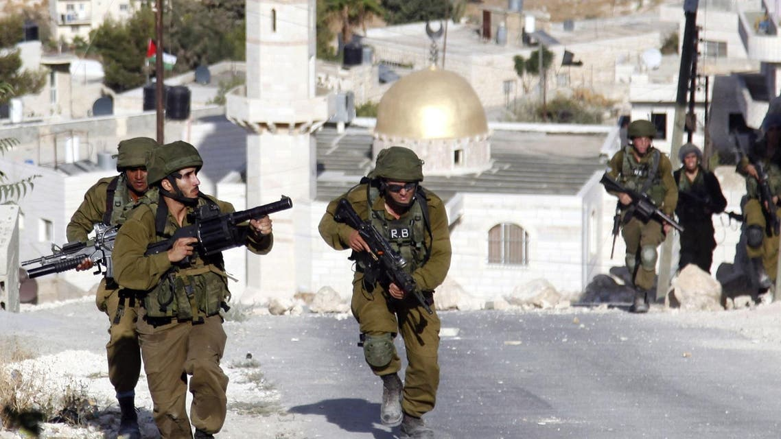 Israeli soldiers are seen during clashes with Palestinians, not seen, in the West Bank village of Tekoa, near Bethlehem. (AP)