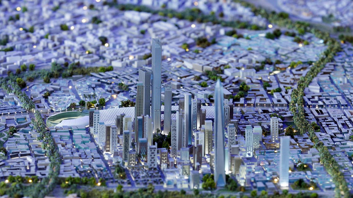 A model of a planned new capital for Egypt is displayed for investors during the final day of Egypt Economic Development Conference (EEDC) in Sharm el-Sheikh, in the South Sinai governorate, south of Cairo, March 28, 2015. When Abu Dhabi-run contractor Arabtec signed a deal with the Egyptian government for a high-profile housing project it was seen as a sign of the Gulf Arab state's support for President Abdel Fattah al-Sisi. But the project announced in March 2014 and a pillar of Sisi's election campaign, has stalled, possibly risking his reputation and highlighting Egypt's habit of promising grandiose ventures and then struggling to deliver. Picture taken March 28, 2015. REUTERS/Amr Abdallah Dalsh TPX IMAGES OF THE DAY