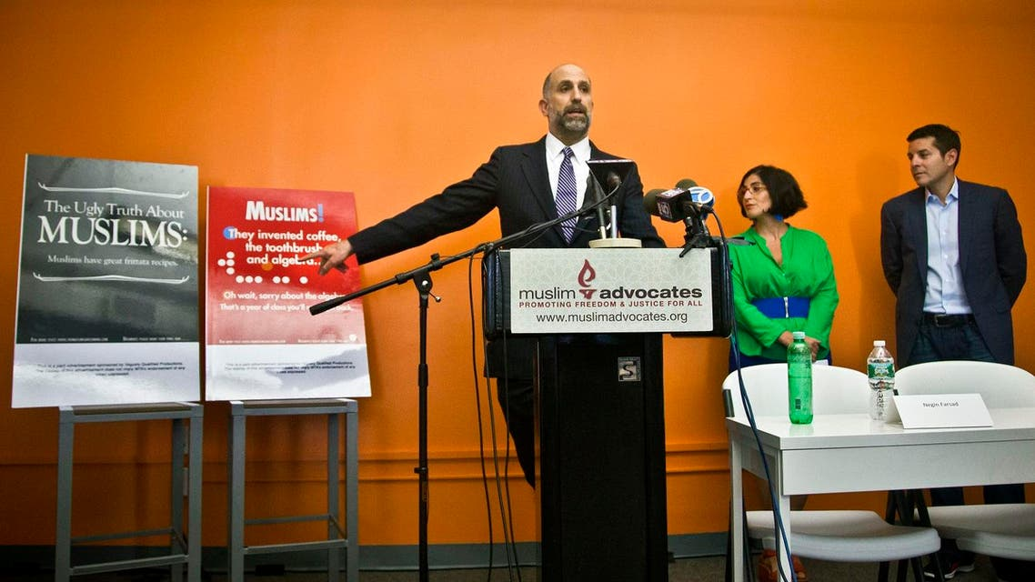 Muslim Advocates Legal Director Glenn Katon, left, and Muslim comedians Negin Farsad, center, and Dean Obeidallah, right, hold a press conference about a lawsuit challenging the Metropolitan Transportation Authority's refusal to run comedic ads about American Muslims like those displayed. (AP)