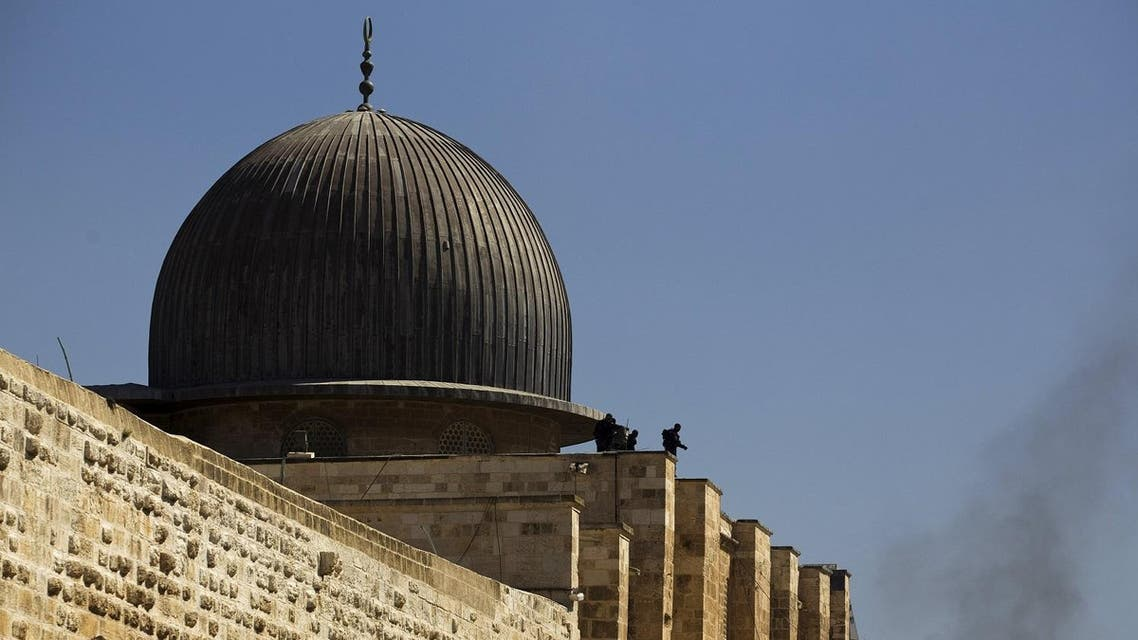 Israeli police officers take positions on the roof of al-Aqsa mosque during clashes with Palestinians in Occupied Jerusalem's Old City. (Reuters)