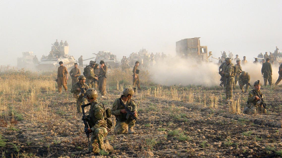 Kurdish troops known as peshmerga deploy during a military operation to regain control of some villages from Islamic State group fighters south of oil-rich city of Kirkuk, 180 miles (290 kilometers) north of Baghdad, Iraq, Wednesday, Aug. 26, 2015. (AP Photo)