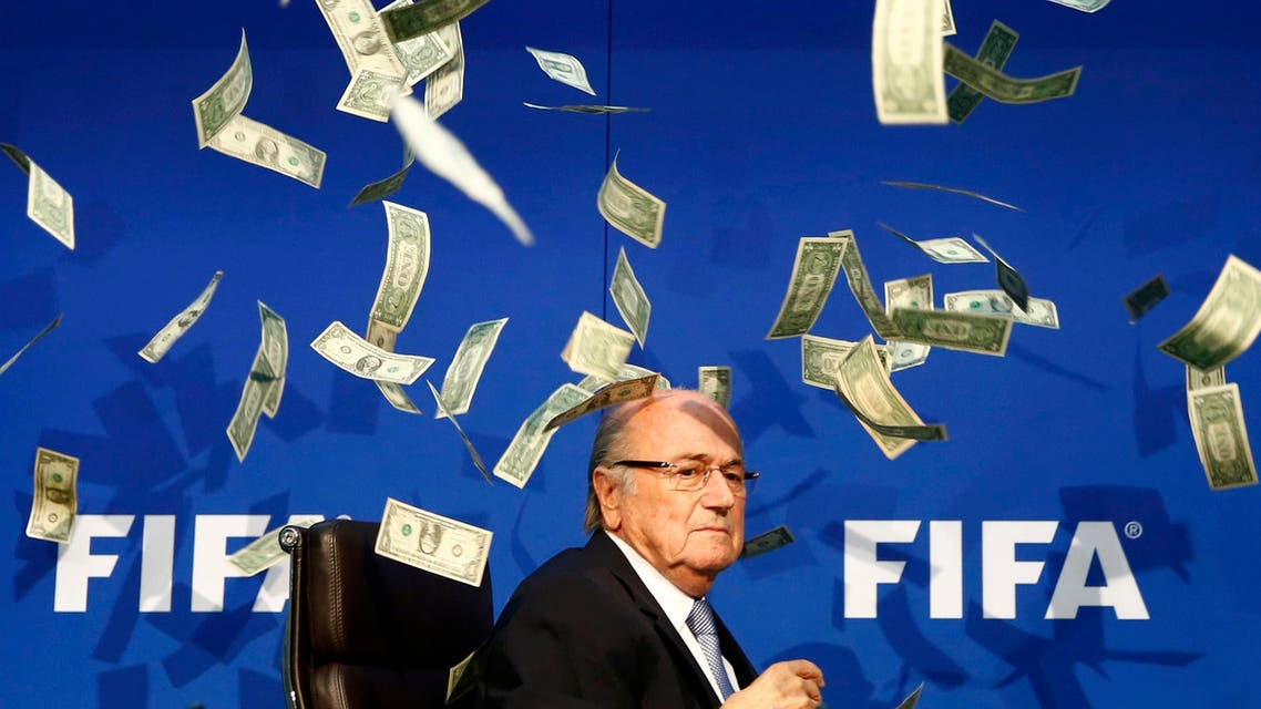 British comedian known as Lee Nelson (unseen) throws banknotes at FIFA President Sepp Blatter as he arrives for a news conference after the Extraordinary FIFA Executive Committee Meeting at the FIFA headquarters in Zurich, Switzerland July 20, 2015. (Reuters)