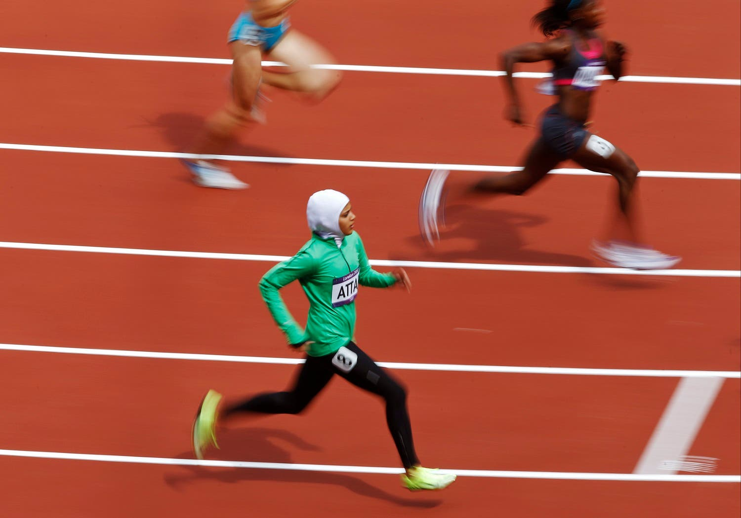 Saudi Arabia's Sarah Attar competes in a women's 800-meter heat during the athletics in the Olympic Stadium at the 2012 Summer Olympics. (AP)