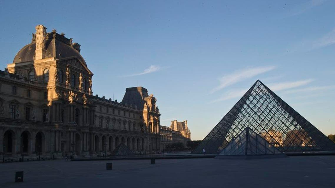 The Louvre museum is seen at sunrise in Paris, Tuesday, Oct. 14, 2014. AP
