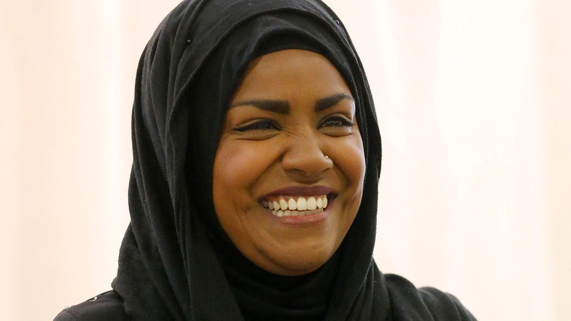 """The Great British Bake Off"" TV show winner Nadiya Hussain smiles as she poses for photographers in London, Thursday, Oct. 8, 2015.  AP"