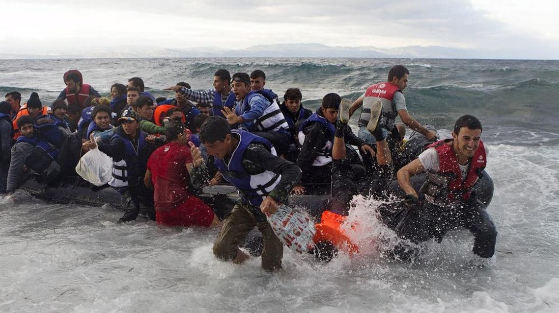 Refugees and migrants struggle to jump off an overcrowded dinghy on the Greek island of Lesbos, after crossing in rough seas from the Turkish coast, October 2, 2015. REU