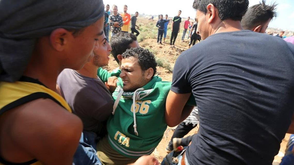Palestinians carry a wounded protester, who was shot by Israeli troops, during clashes near the Israeli border fence in northeast Gaza October 9, 2015. (Reuters)