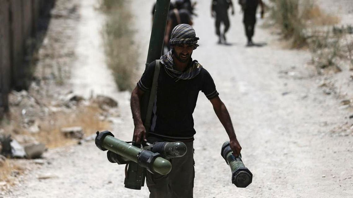 A fighter from the Free Syrian Army's Al Rahman legion carries a weapon as he walks towards his position on the front line against the forces of Syria's President Bashar al-Assad in Jobar, a suburb of Damascus. (File photo: Reuters)