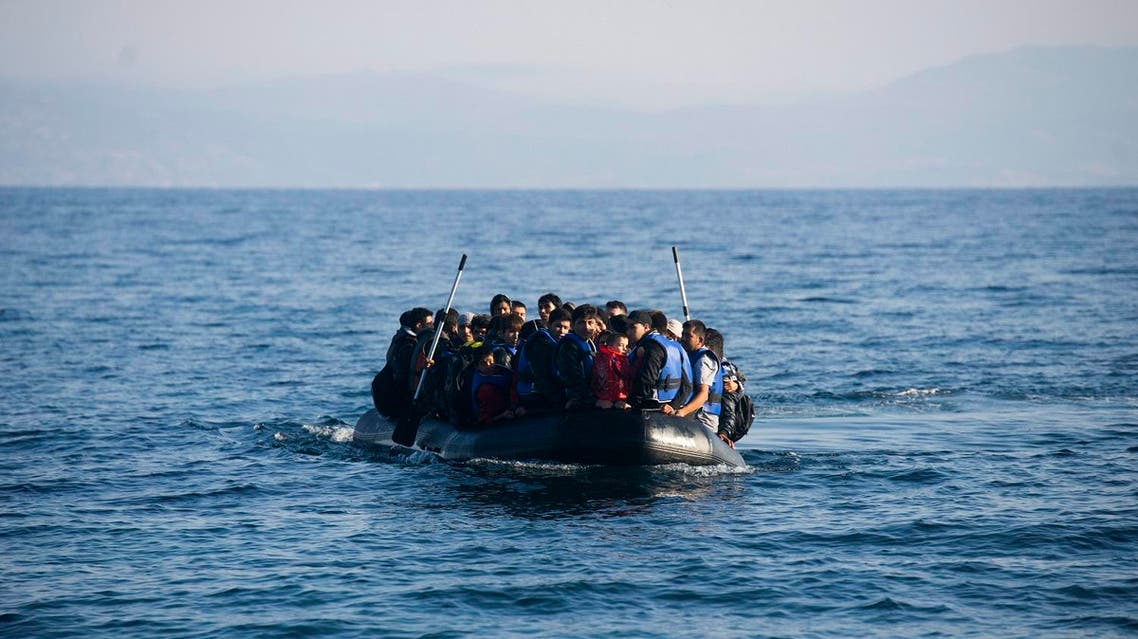 Migrants arrive in an overloaded rubber dinghy at the coast near Skala Sikaminias, Lesbos island. (AP)
